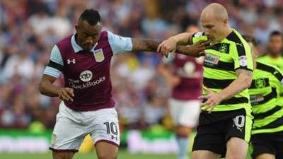 Jordan Ayew of Aston Villa and Aaron Mooy of Huddersfield