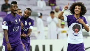 Asamoah Gyan and Omar Abdulrahman of Al Ain