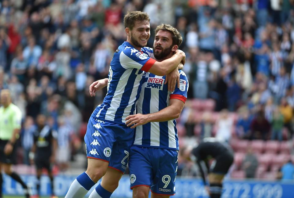 Will Grigg celebrates his goal against Blacburn