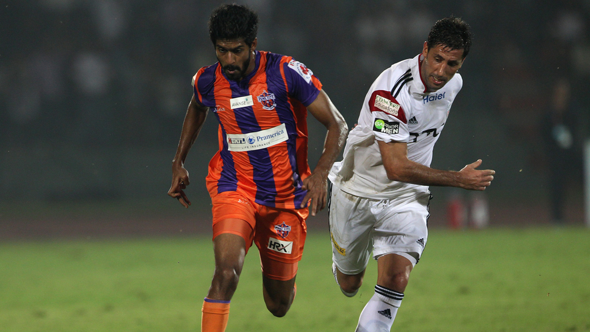 Ashutosh Mehta of FC Pune City and Joan Capdevila of NorthEast United FC in action during ISL match