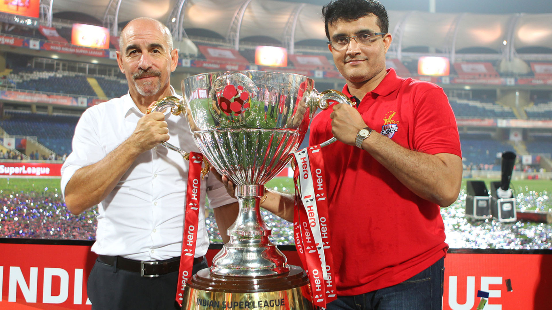 Atletico de Kolkata coach Antonio Lopez Habas and Sourav Ganguly with the ISL trophy