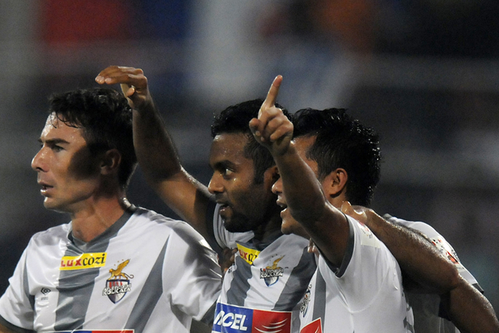 Cavin Lobo of Atletico de Kolkata celebrates goal with teammates  during ISL match against FC Goa