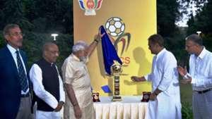 Shri Narendra Modi unveiling the BRICS U-17 Football Tournament trophy