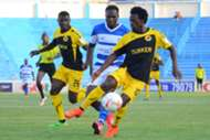Tusker FC players Kevin Kimani and Noah Wafula against Jackson Saleh of AFC Leopards