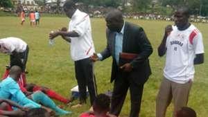 Shabana FC coach Gilbert Selebwa speaks to players at half-time break.