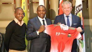Harambee Stars coach Paul Put and Nick Mwendwa