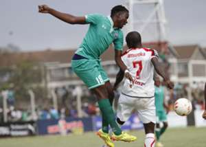 Gor Mahia ace Haroun Shakava goes for the high ball under pressure from Evans Amuoka of Ulinzi Stars