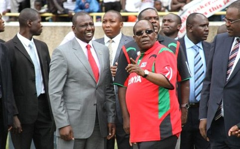 Deputy President Williamson Ruto and FKF boss Sam Nyamweya at Kasarani