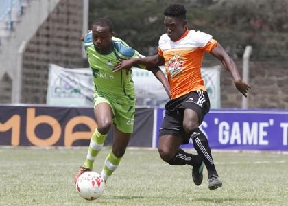 Athman Buki (l) of KCB tackles Eric Omonge of Nakuru All Stars