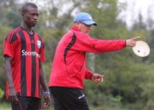 Moussa Sissoko of AFC Leopards with coach Ivan Minnaert