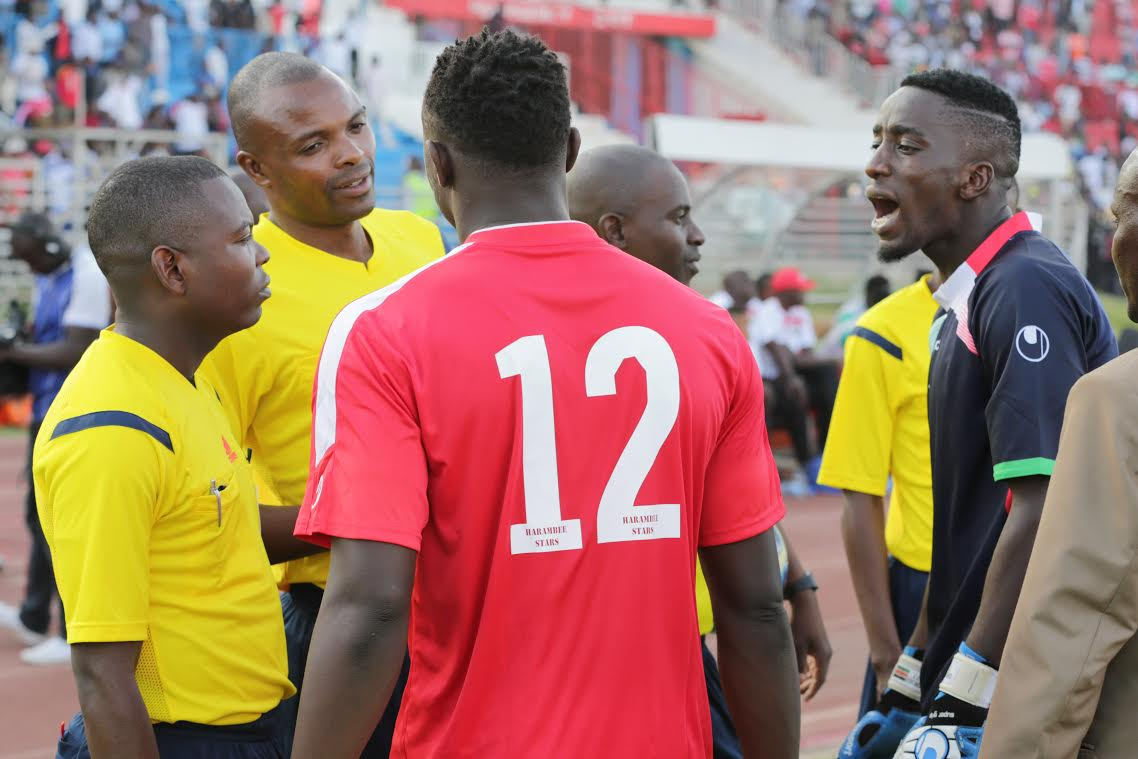 Kenya captain Victor Wanyama and goalie Arnold Origi argue with match officials