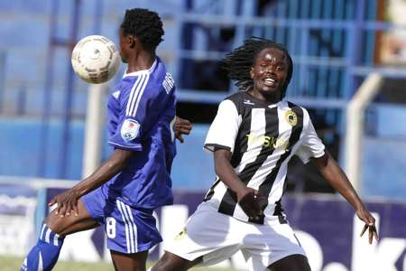 Nairobi City Stars striker Arthur Museve v Shafiq Batambuze of Tusker