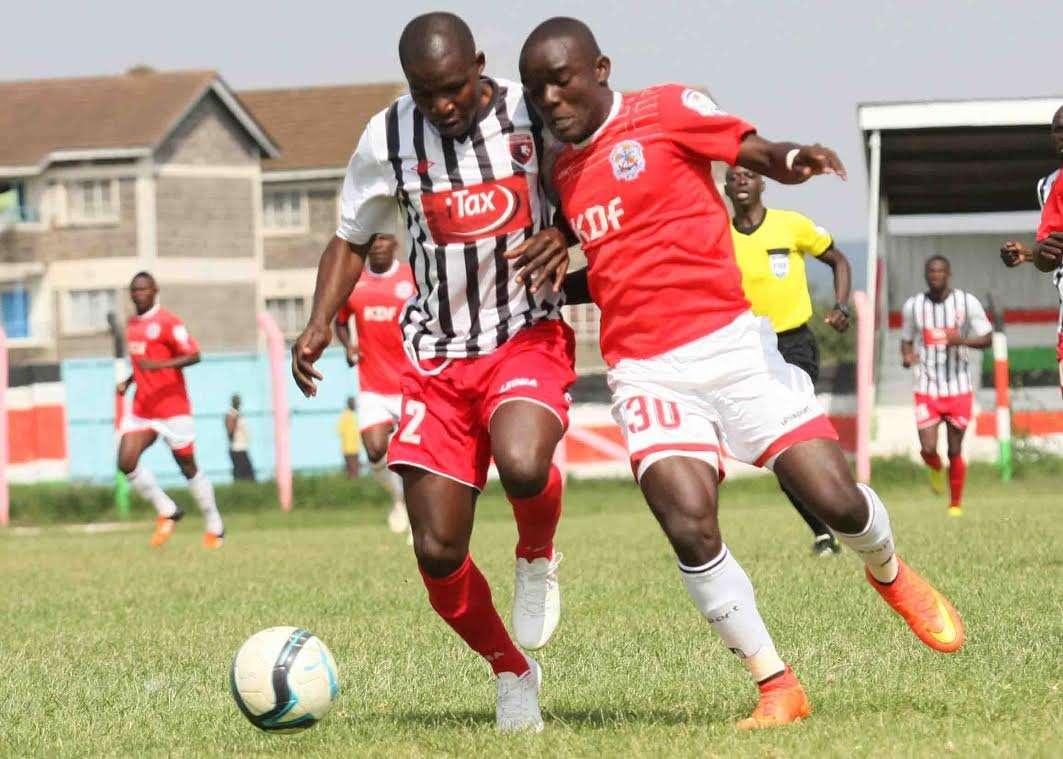 Ulinzi Stars striker John Makwatta tackles a Ushuru FC opponent