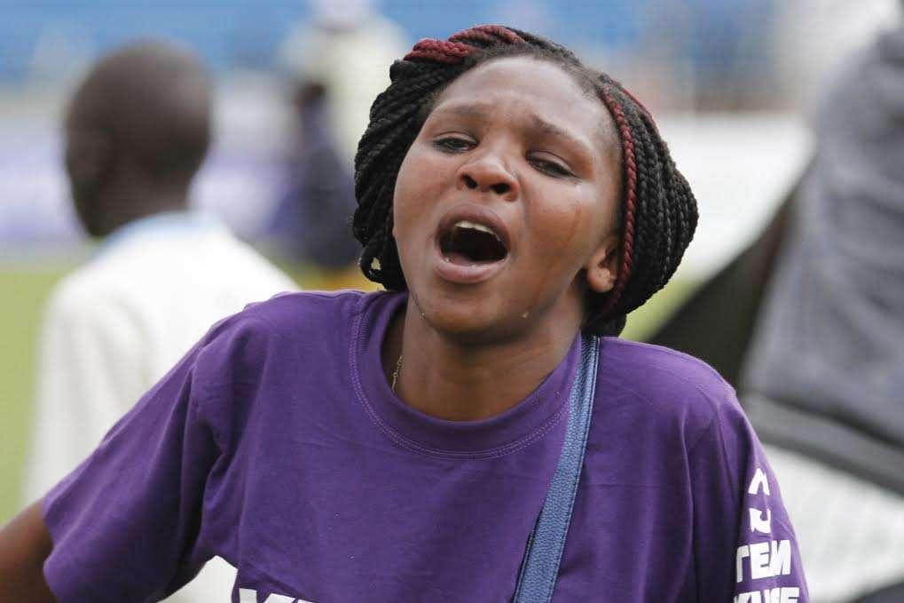 A fan of Eastleigh 'Slum Boys' Kiambio breaks down into tears after his side lost on penalties to TUK on Sunday