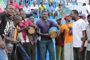 Harambee Stars fans cheer on their team in the match played at Nyayo Stadium