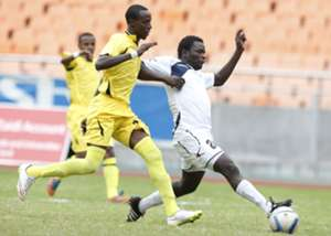 Mohamed Kader (L) of Telecom FC tackle Enock Agwanda of Gor Mahia FC