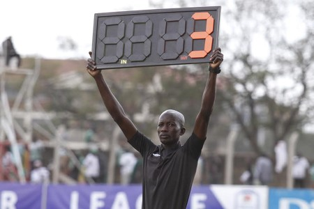 A fourth official displays board time during Nakuru All Stars v KCB tie