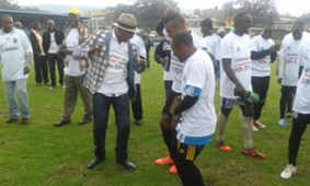 Sofapaka President Elly Kalekwa joins players to celebrate GOtv Shield trophy