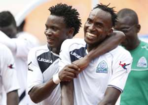 George Odhiambo and teammate Karim Nizigiyimana of Gor Mahia celebrate