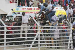 Kenyan fans invade the pitch at the end of the match played at Nyayo Stadium