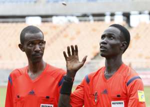 Referee Malong Ring Nyier (R) from South Sudan toss a coin before his assistant Kakunze Herve from Burundi before Telecom FC v Gor Mahia kick-off.