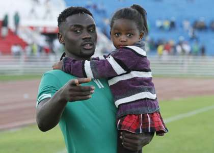 Gor Mahia captain Musa Mohammed with his daughter after trophy presentation