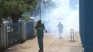 Gor Mahia fans run to safety after police were forced to use teargas