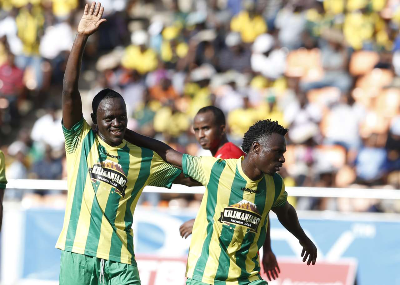 Malimu Busungu (L) of Yanga FC celebrates his goal against Djibouti Telecom FC. Yanga won 3-0.