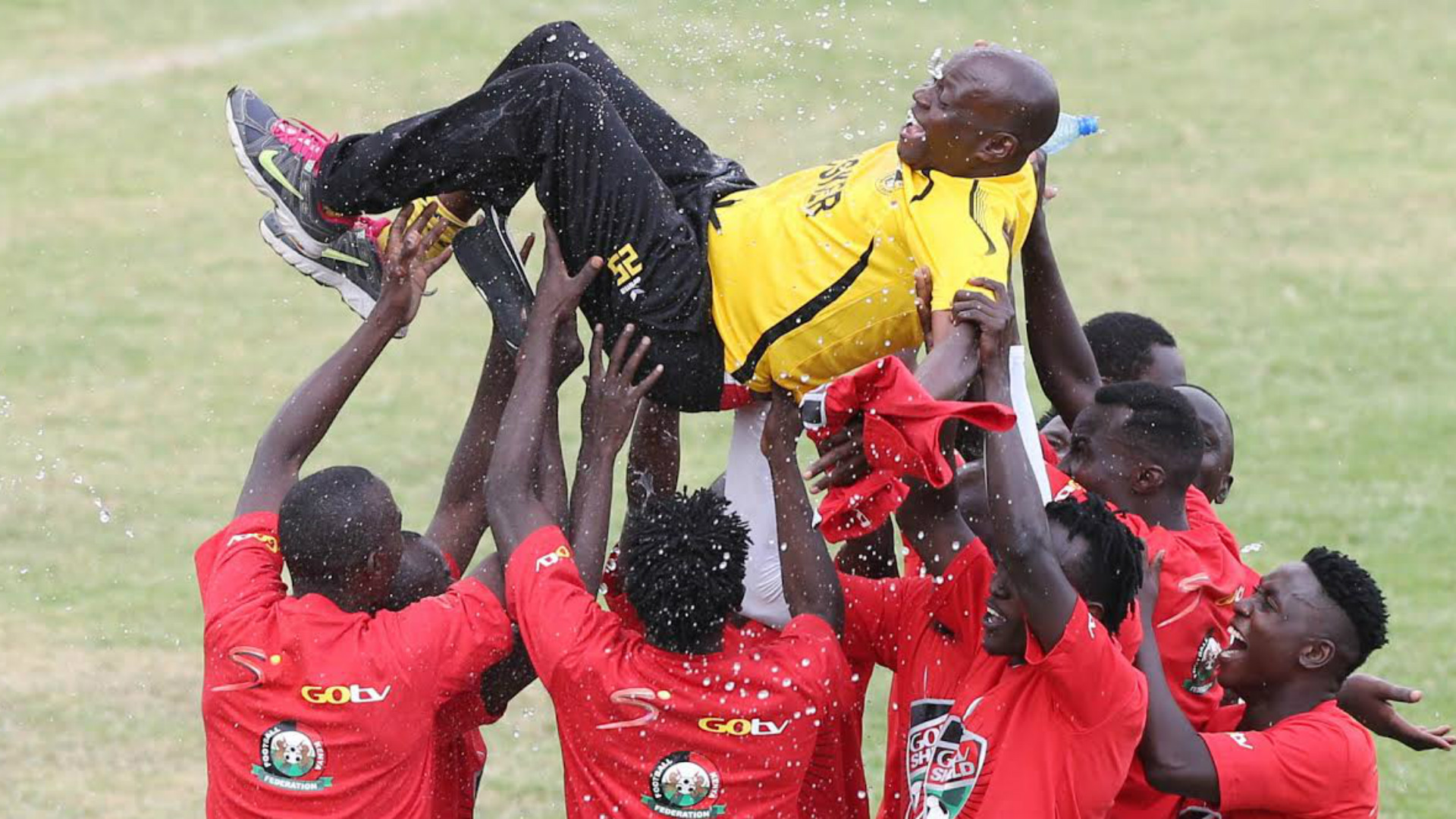 Tusker coach Paul Nkata is tossed up by players at the final whistle of GOtv Shield final