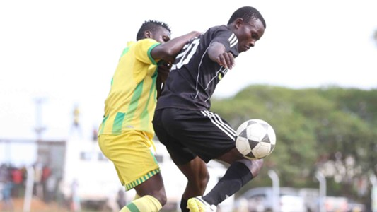 Patillah Omoto of Kariobangi Sharks (L) tackle Masita Masuta