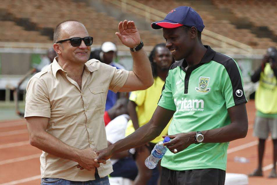 AFC Leopards coach Zdravko Logarusic embraces with Stanley Okumbi of Mathare United at the final whistle of the 0-0 draw
