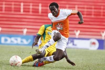 Mathare United midfielder Noah Abich tackles Hilary Echesa of Nakuru All Stars