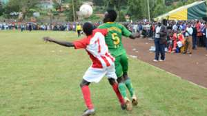 Shabana FC player battles for the ball with a Finlay opponent.