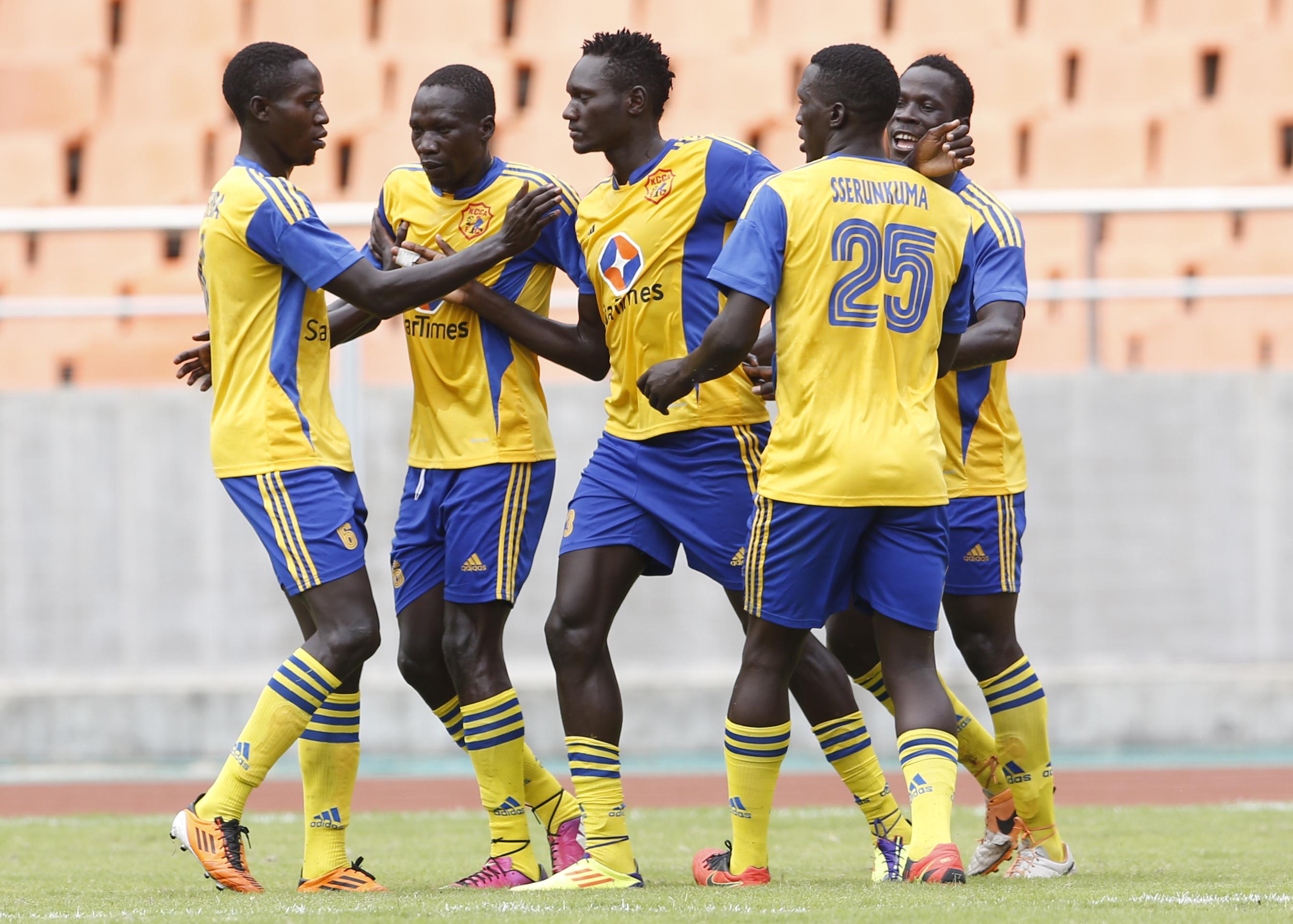 KCCA FC players celebrate Joseph Ochaya's (C) goal against Al Shandy