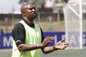Ushuru FC coach Ken Kenyatta applauds his charges after they grinded out a slim win over the sugar millers