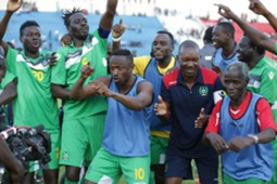 Guinea Bissau players celebrate at the final whistle as the win takes them on top of Group E
