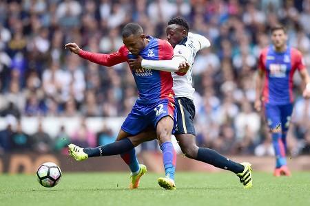 Jason Puncheon of Crystal Palace is tackled by Victor Wanyama of Tottenham Hotspur