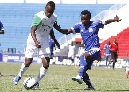 Gor Mahia's Ronald Omino tackle Calvin Masawa of City Stars