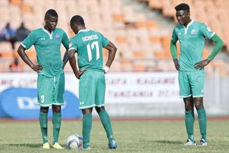 Gor Mahia players Abouba Sibomana (l), Erick Ochieng (c) and Michael Olunga