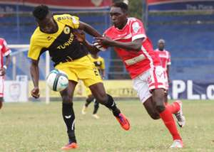 Tusker winger Noah Wafula takes on Wesley Onguso of Western Stima