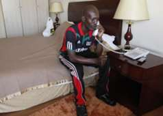 Harambee Stars team manager Willis Waliaula makes frantic efforts to secure his release after being detained for unpaid bills in Ethiopia