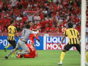 Rizal Ghazali (far left) in action for Malaysia against Singapore