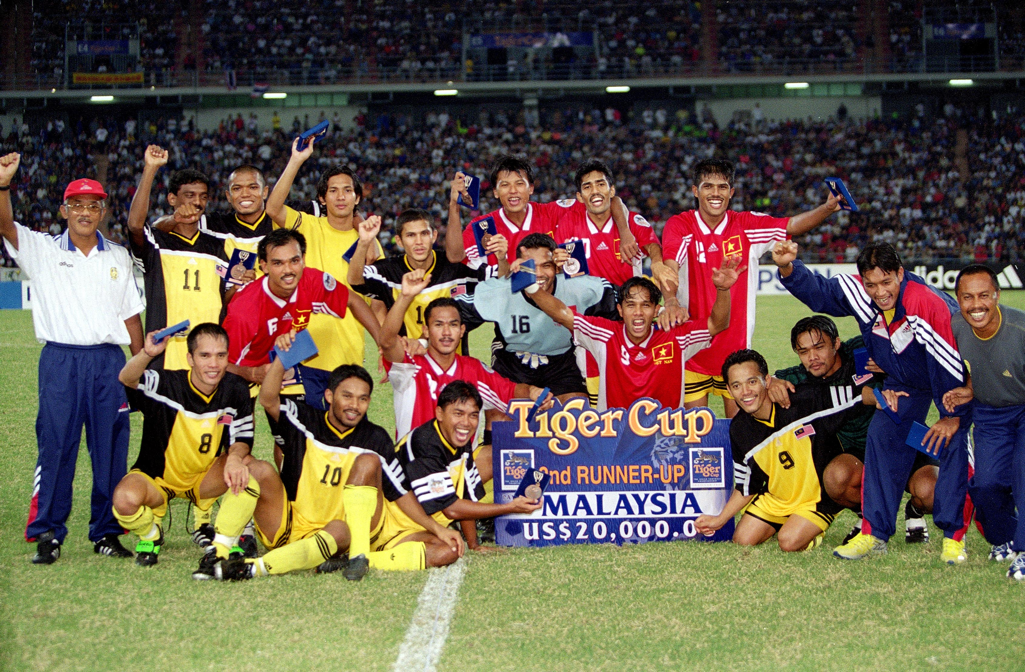 Malaysia team celebrating finishing third in the 2000 AFF Cup