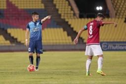 PDRM's Andrezinho and Johor Darul Ta'zim's Safiq Rahim giving instructions to their teammates 2016