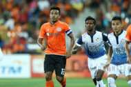 Felda United's Shukor Adan vies for the ball with PDRM's K. Reuben 2016