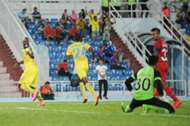 Pahang hitman Dickson Nwakaeme wheels away in celebration after scoring against ATM.