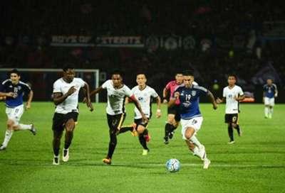 Johor Darul Ta'zim's Juan Martin Lucero (in blue) tries to get away from Terengganu players 9/9/2016