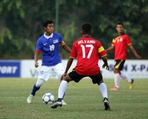 Malaysia U19's Syahmi Safari (left) tries to get past Timor Leste U19's Gelvanio Alberto 17/9/2016
