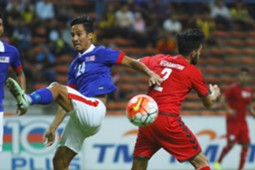 Malaysia's Matthew Davies (left) vies for the ball with an Afghanistan player 11/10/2016