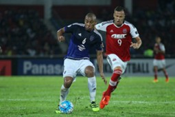 Johor Darul Ta'zim's Marcos Antonio protects the ball from South China's Nikola Komazec